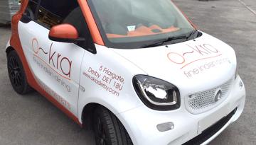 o~kra Smart Car Signage